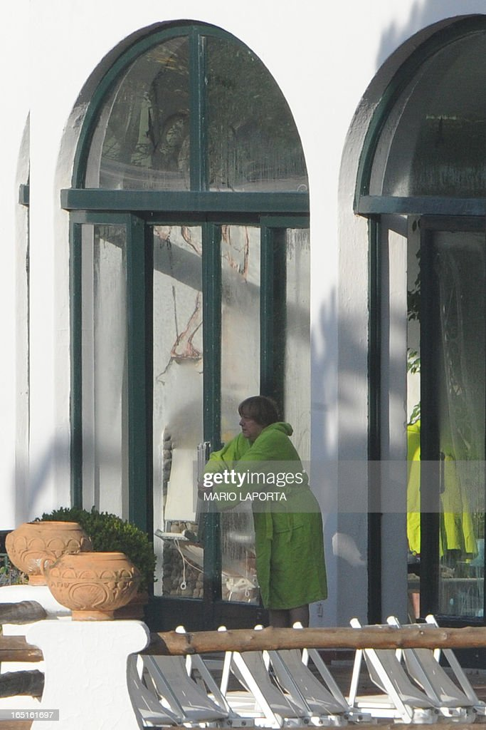 German Chancellor Angela Merkel is pictured at the swimming pool of the Aphrodite Terme in the coastal town of Sant'Angelo d'Ischia on the southern Italy's Island of Ischia during their Easter holiday on April 1st, 2013.
