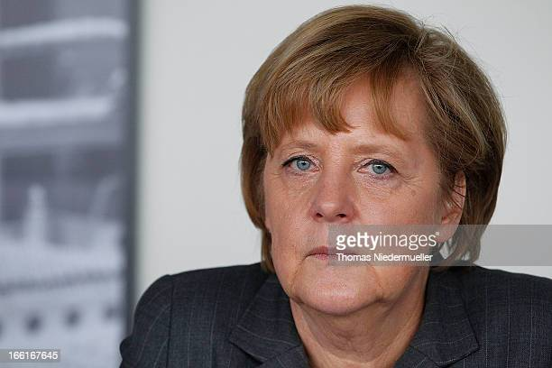 German Chancellor Angela Merkel is seen at the Mader GmbH company on April 9 2013 in LeinfeldenEchterdingen Germany The Mader company specializes in...