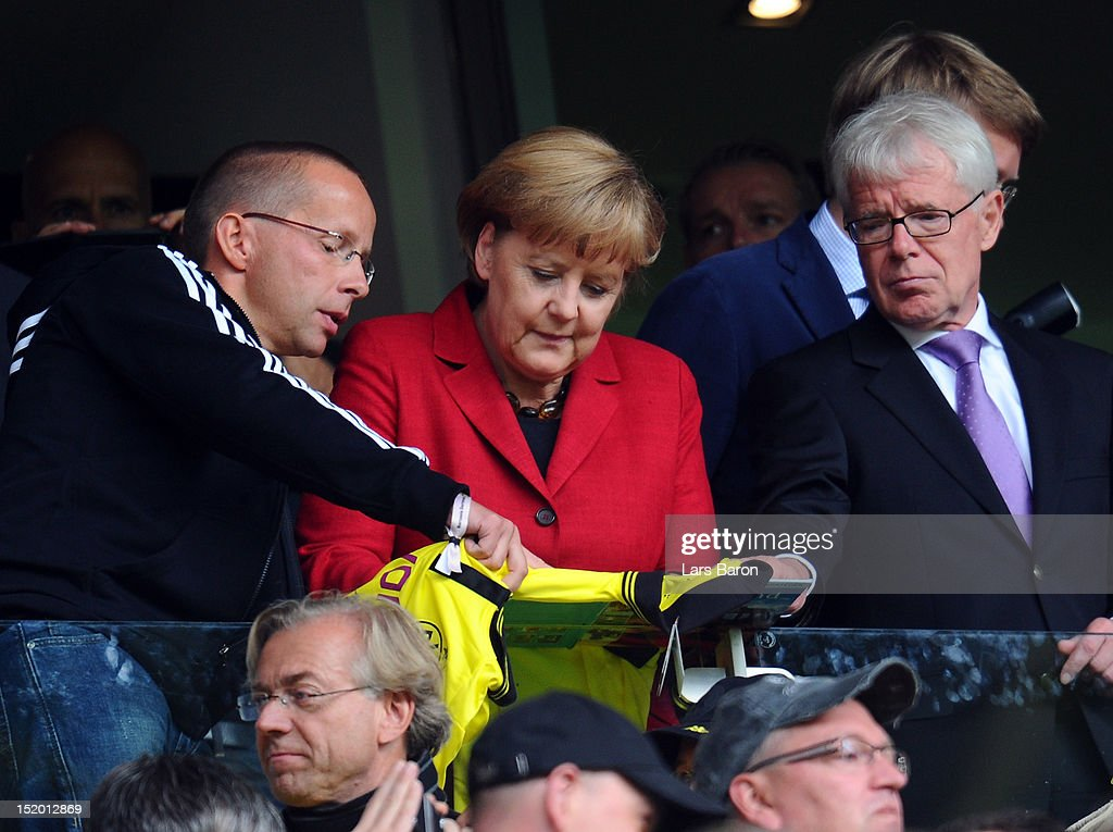German Chancellor <a gi-track='captionPersonalityLinkClicked' href=/galleries/search?phrase=Angela+Merkel&family=editorial&specificpeople=202161 ng-click='$event.stopPropagation()'>Angela Merkel</a> is seen next to <a gi-track='captionPersonalityLinkClicked' href=/galleries/search?phrase=Reinhard+Rauball&family=editorial&specificpeople=652253 ng-click='$event.stopPropagation()'>Reinhard Rauball</a>, president of Deutsche Fussball Liga DFL and Borussia Dortmund, during the Bundesliga match between Borussia Dortmund and Bayer 04 Leverkusen at Signal Iduna Park on September 15, 2012 in Dortmund, Germany.