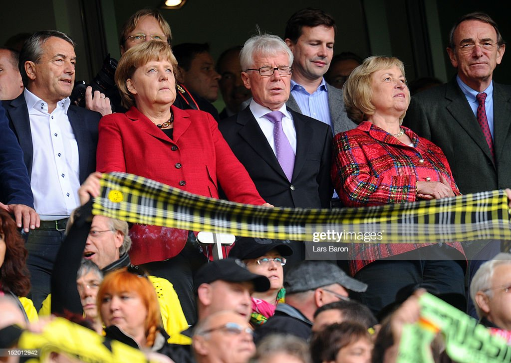 German Chancellor Angela Merkel is seen next to Reinhard Rauball, president of Deutsche Fussball Liga DFL, (r) and Wolfgang Niersbach, president of Deutsche Fussball Bund DFB, (l) during the Bundesliga match between Borussia Dortmund and Bayer 04 Leverkusen at Signal Iduna Park on September 15, 2012 in Dortmund, Germany.