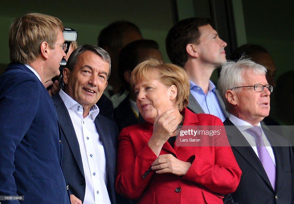 German Chancellor Angela Merkel is seen next to Reinhard Rauball, president of Deutsche Fussball Liga DFL, (r) and Wolfgang Niersbach, president of Deutsche Fussball Bund DFB, (l) during the Bundesliga match between Borussia Dortmund and Bayer 04 Leverkusen at Signal Iduna Park on September 15, 2012 in Dortmund, Germany.