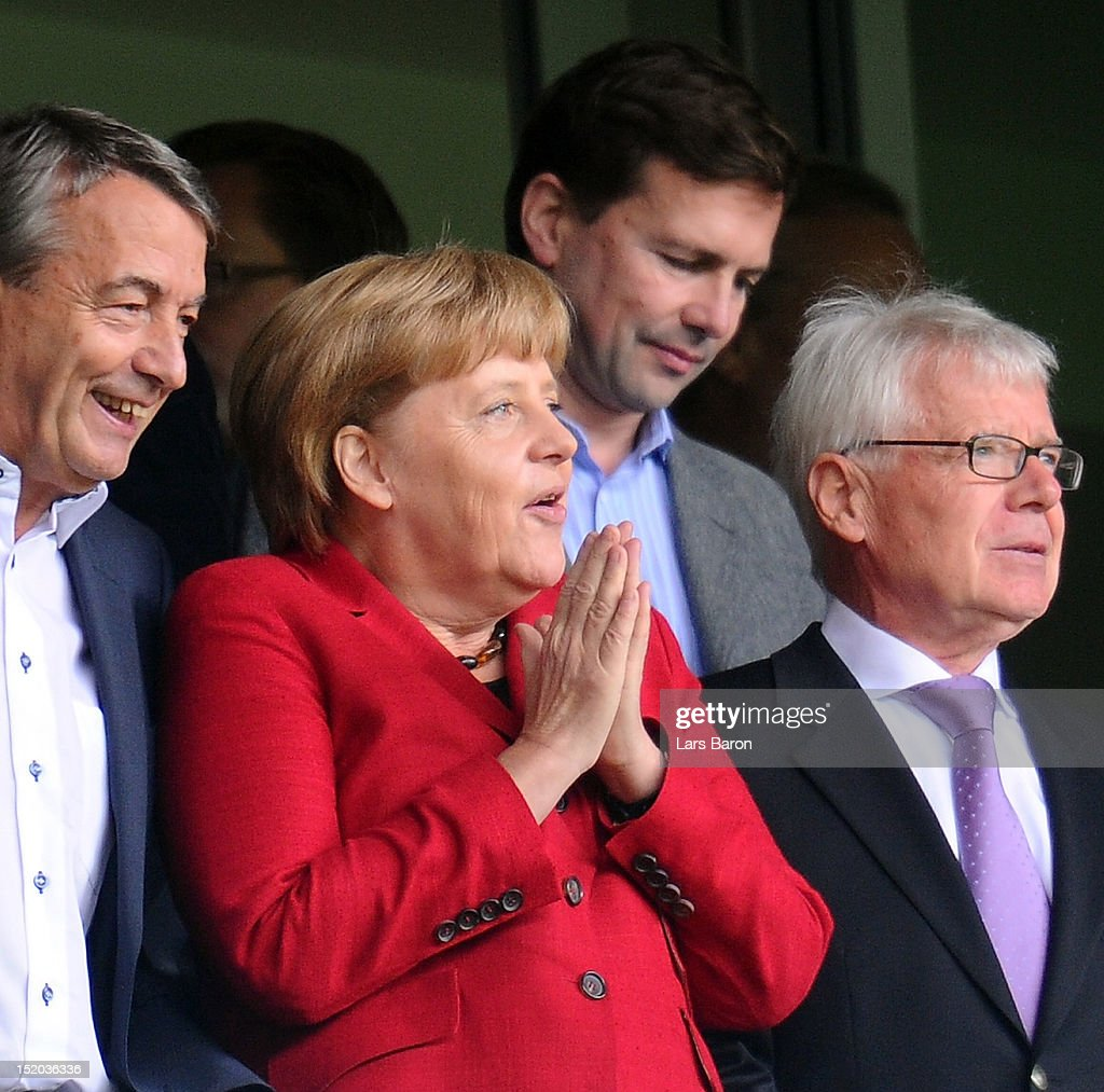 German Chancellor <a gi-track='captionPersonalityLinkClicked' href=/galleries/search?phrase=Angela+Merkel&family=editorial&specificpeople=202161 ng-click='$event.stopPropagation()'>Angela Merkel</a> is seen next to <a gi-track='captionPersonalityLinkClicked' href=/galleries/search?phrase=Reinhard+Rauball&family=editorial&specificpeople=652253 ng-click='$event.stopPropagation()'>Reinhard Rauball</a>, president of Deutsche Fussball Liga DFL, (r) and <a gi-track='captionPersonalityLinkClicked' href=/galleries/search?phrase=Wolfgang+Niersbach&family=editorial&specificpeople=555796 ng-click='$event.stopPropagation()'>Wolfgang Niersbach</a>, president of Deutsche Fussball Bund DFB, (l) during the Bundesliga match between Borussia Dortmund and Bayer 04 Leverkusen at Signal Iduna Park on September 15, 2012 in Dortmund, Germany.