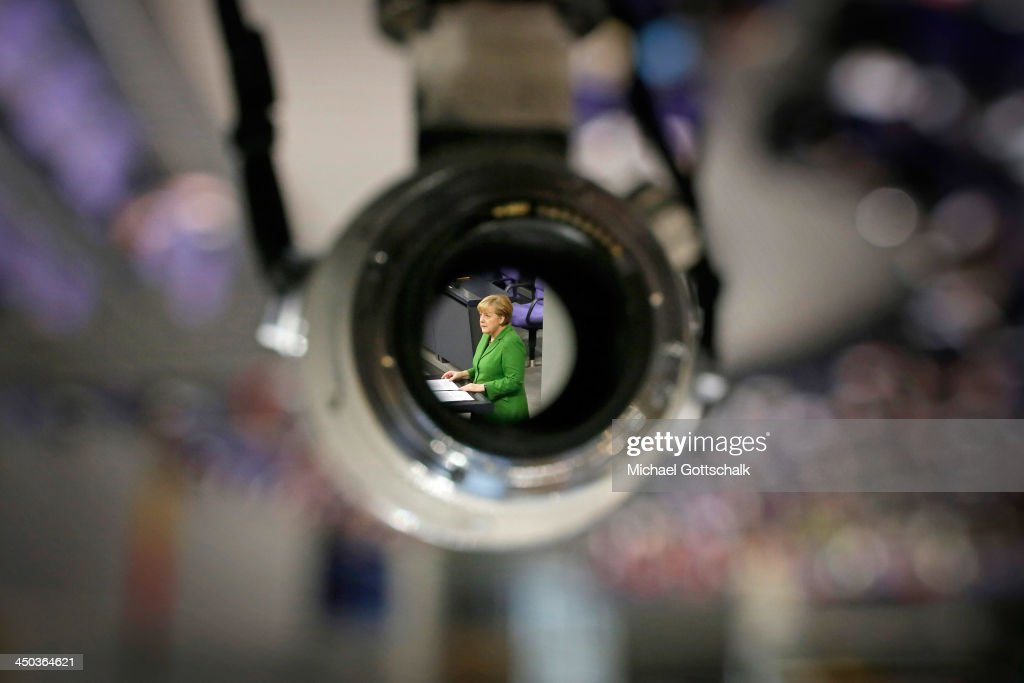 German Chancellor Angela Merkel is seen through a telephoto lens during her speach at the Reichstag, the seat of german bundestag on November 18, 2013 in Berlin, Germany. The Bundestag were debating the activities in Germany of the US-Intelligence Service NSA.