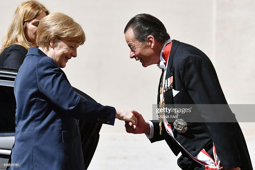 German Chancellor Angela Merkel (L) is welcomed as she arrives at the Vatican on May 6, 2016 for an audience with Pope Francis. Merkel is in Rome to take part in a ceremony for the awarding of Germany's famed Charlemagne Prize to Pope Francis, given to public figures in recognition of contribution to European unity. / AFP / TIZIANA