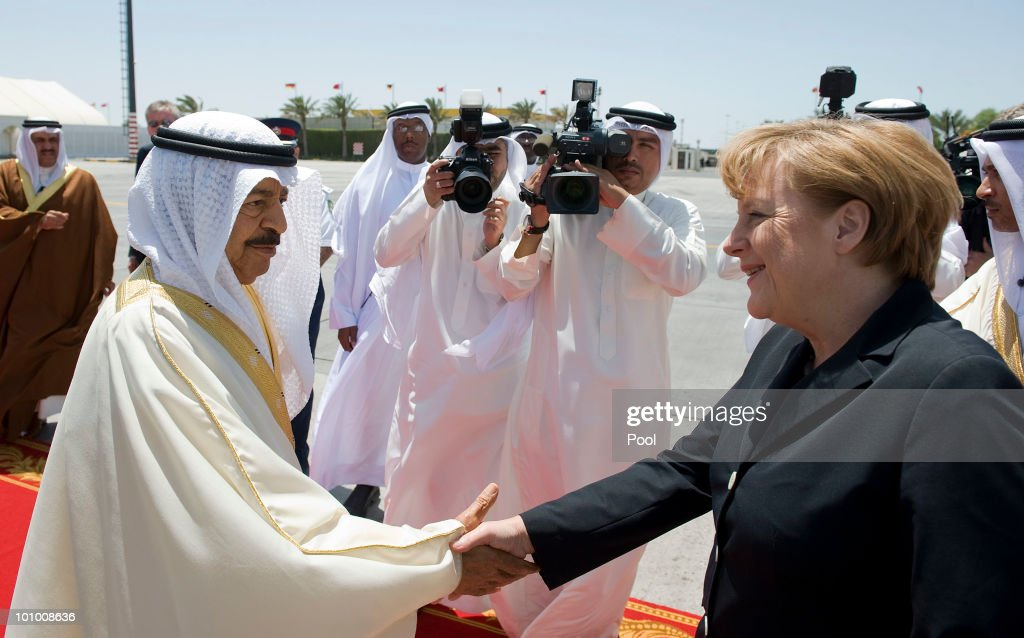 German Chancellor <a gi-track='captionPersonalityLinkClicked' href=/galleries/search?phrase=Angela+Merkel&family=editorial&specificpeople=202161 ng-click='$event.stopPropagation()'>Angela Merkel</a> is welcomed by Bahrain's premier Khalifa bin Salman Al Khalifa during her Gulf States trip on May 27, 2010 in Manama, Bahrain. Merkel began her four-day tour of the Gulf region in the United Arab Emirates on May 24 to promote the Middle East peace process. Political talks in the United Arab Emirates, Bahrain, Qatar and Saudi Arabia will also be dominated by regional security issues and the nuclear standoff with Iran.