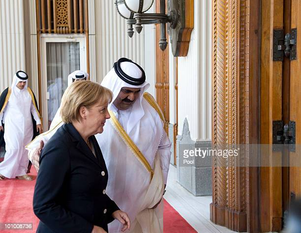 German Chancellor Angela Merkel is welcomed by Qatar's Emir Hamad bin Khalifa Al Thani at the Emiri Diwan on May 27 2010 in Doha Qatar Merkel began...