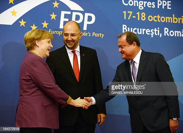 German Chancellor Angela Merkel is welcomed by Romanian Democratic Party President Vasile Blaga and Kelemen Hunor the President of Democratic Union...