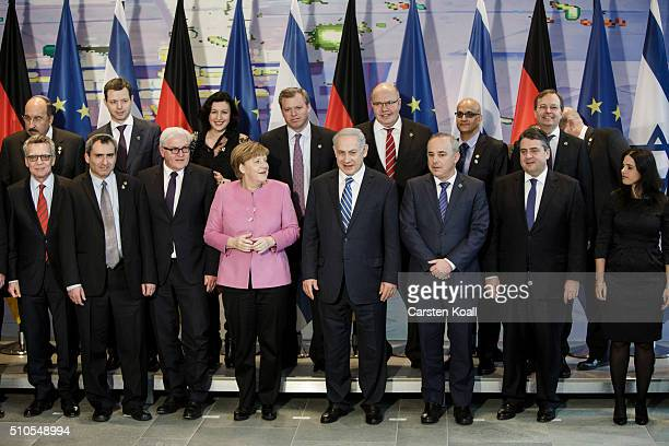 German Chancellor Angela Merkel Israeli Prime Minister Benjamin Netanyahu and other government members pose for a familypicture during the 6th...