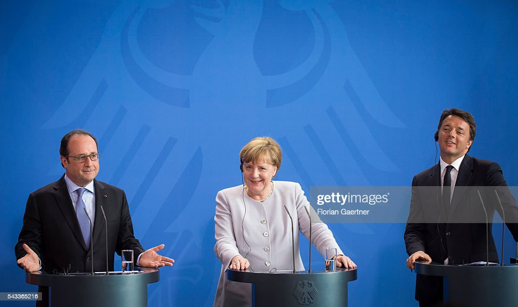 German Chancellor Angela Merkel (C), Italian Prime Minister Matteo Renzi (R) and French President Francois Hollande (L) attend a press conference on June 27, 2016 in Berlin, Germany. Merkel hosted talks with Hollande and Renzi to discuss the UK's decision to leave the European Union.
