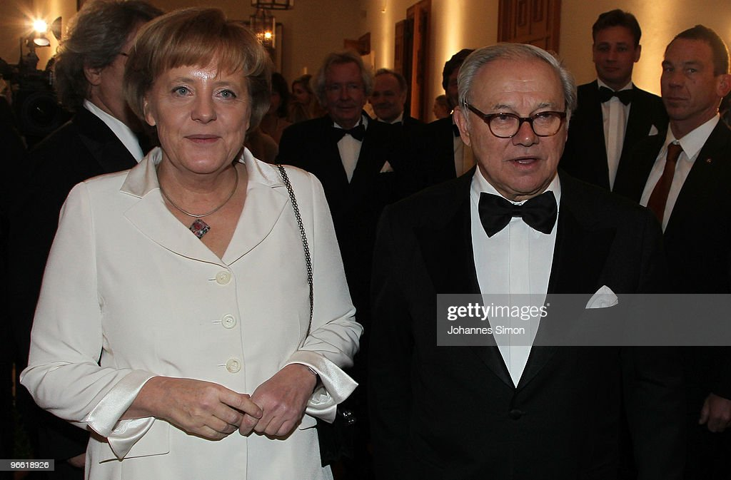 German Chancellor Angela Merkel L) and Hubert Burda, head of the Hubert Burda Media Holding arrive for the Hubert Burda Birthday Reception at Munich royal palace on February 12, 2010 in Munich, Germany.
