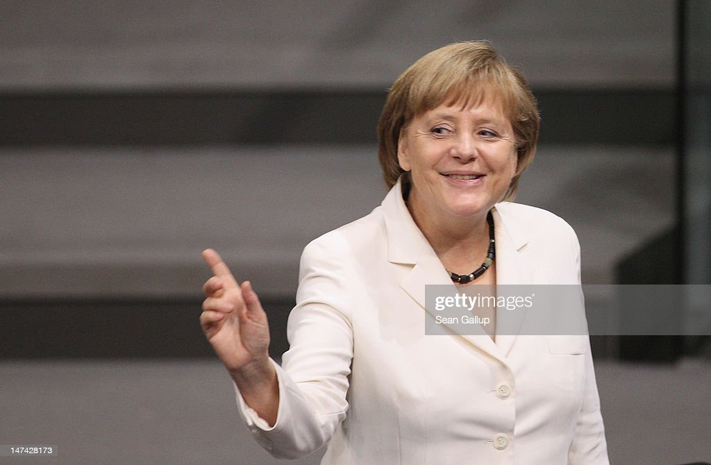 German Chancellor <a gi-track='captionPersonalityLinkClicked' href=/galleries/search?phrase=Angela+Merkel&family=editorial&specificpeople=202161 ng-click='$event.stopPropagation()'>Angela Merkel</a> laughs at the remark of a colleague pior to a vote in the Bundestag on Germany's ratification of the European Stability Mechanism (ESM) and the European Union fiscal pact on June 29, 2012 in Berlin, Germany. The two measures together will provide a cushion for debt-stricken members yet also create far-reaching changes to the ability of the European Union to influence member states' individual fiscal policy.