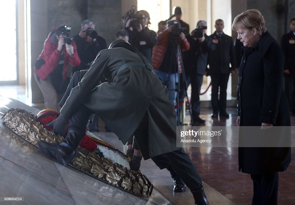 German Chancellor Angela Merkel (C) lays wreath at mausoleum of Mustafa Kemal Ataturk, founder of the Republic of Turkey, during her visit to Ankara, Turkey on February 8, 2016.