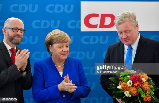 German Chancellor Angela Merkel leader of the conservative Christian Democratic Union and CDU secretary general Peter Tauber applaud Bernd Althusmann...