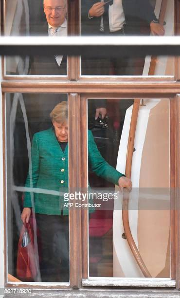 German Chancellor Angela Merkel leader of the conservative Christian Democratic Union and Bavaria's Interior Minister Joachim Herrmann of the CDU's...