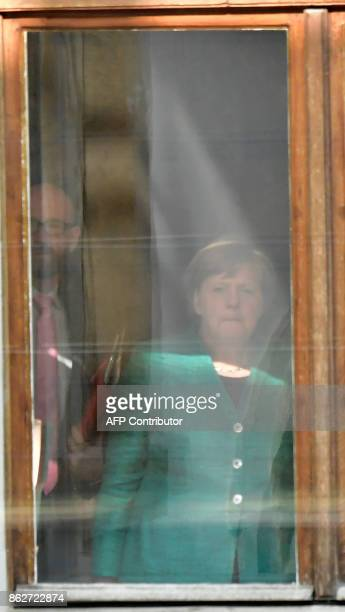 German Chancellor Angela Merkel leader of the conservative Christian Democratic Union and her party's secretary general Peter Tauber are seen behind...