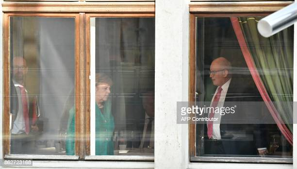 German Chancellor Angela Merkel leader of the conservative Christian Democratic Union her party's secretary general Peter Tauber and Volker Kauder...