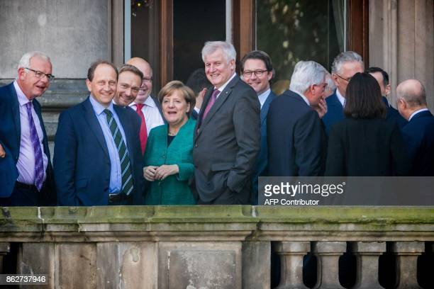 German Chancellor Angela Merkel leader of the conservative Christian Democratic Union and Horst Seehofer leader of the Christian Social Union stand...