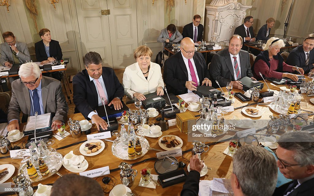 German Chancellor Angela Merkel (C) leads a meeting of the German government cabinet, including (from L to R) Foreign Minister <a gi-track='captionPersonalityLinkClicked' href=/galleries/search?phrase=Frank-Walter+Steinmeier&family=editorial&specificpeople=603500 ng-click='$event.stopPropagation()'>Frank-Walter Steinmeier</a>, Vice Chancellor and Economy and Energy Minister Sigmar Gabriel and Minister of the Chancellery Peter Altmeier, together with European Commissioner for Energy in the European Commission Guenther Oettinger at Schloss Meseberg palace on May 24, 2016 in Gransee, Germany. The government cabinet is meeting at Schloss Meseberg for a two-day retreat.
