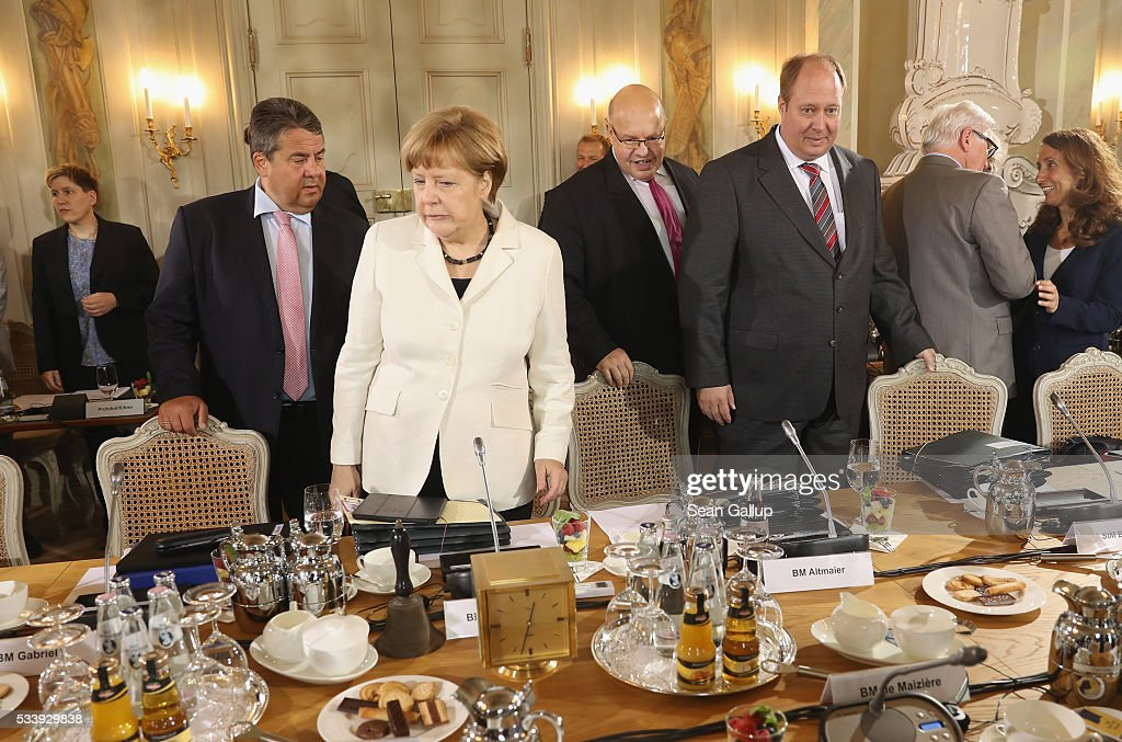 German Chancellor Angela Merkel (C) leads a meeting of the German government cabinet, including Vice Chancellor and Economy and Energy Minister Sigmar Gabriel (L) and Minister of the Chancellery Peter Altmeier (C-R), together with European Commissioner for Digital Economy and Society Guenther Oettinger at Schloss Meseberg palace on May 24, 2016 in Gransee, Germany. The government cabinet is meeting at Schloss Meseberg for a two-day retreat.