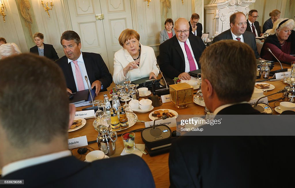 German Chancellor Angela Merkel leads a meeting of the German government cabinet together with European Commissioner for Energy in the European Commission Guenther Oettinger at Schloss Meseberg palace on May 24, 2016 in Gransee, Germany. The government cabinet is meeting at Schloss Meseberg for a two-day retreat.