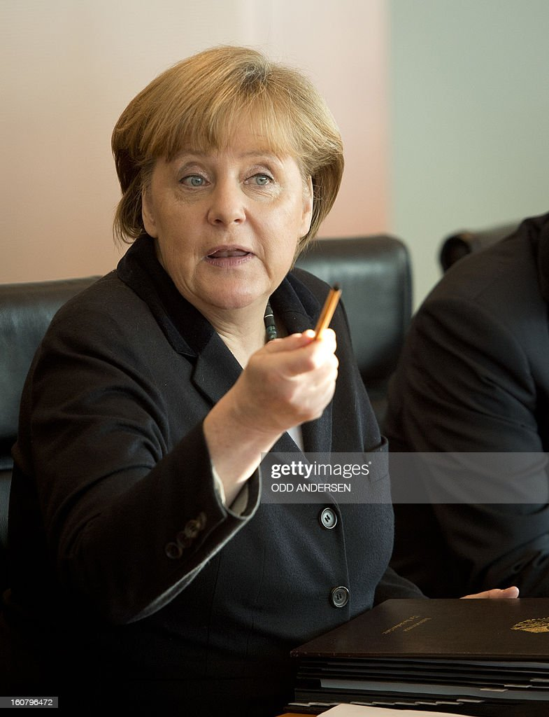 German Chancellor Angela Merkel leads the weekly cabinet meeting seated next to her chief of staff Roland Pofalla at the Chancellery in Berlin on February 6, 2013. Germany's education minister and a close ally of Chancellor Angela Merkel was fighting for her political life Wednesday after having her doctorate revoked for plagiarism.