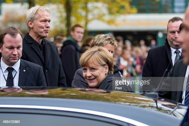 German Chancellor Angela Merkel leaves after a memorial for the Germanwings plane crash victims including children and teachers from the Joseph King...