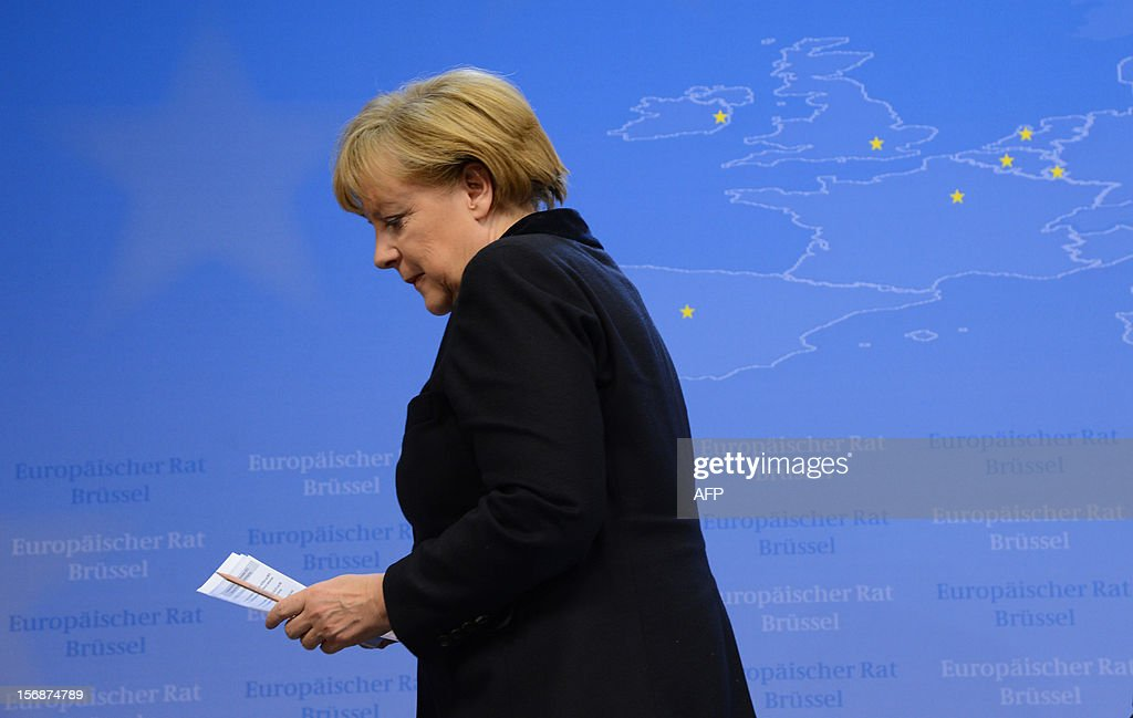 German Chancellor Angela Merkel leaves after a press conference at the EU Headquarters, on November 23, 2012 in Brussels, after a two-day European Union leaders summit called to agree a hotly-contested trillion-euro budget through 2020. EU Council President Herman Van Rompuy said today that an EU budget deal was within reach early next year, after a two-day summit collapsed without agreement.