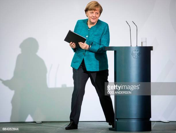 German Chancellor Angela Merkel leaves after giving a speach during the national integration awards ceremony at the Chancellery in Berlin on May 17...