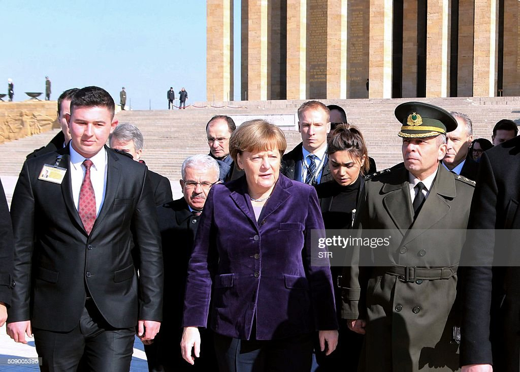 German Chancellor Angela Merkel (C) leaves after her visit to Anitkabir, the mausoleum of Mustafa Kemal Ataturk, founder of the Republic of Turkey, during her visit to Ankara on February 8, 2016. Merkel is to hold talks with Turkey's President Recep Tayyip Erdogan and Prime Minister Ahmet Davutoglu to press Turkey to strengthen border controls to stem the flow of migrants and refugees heading for Europe. / AFP / STR
