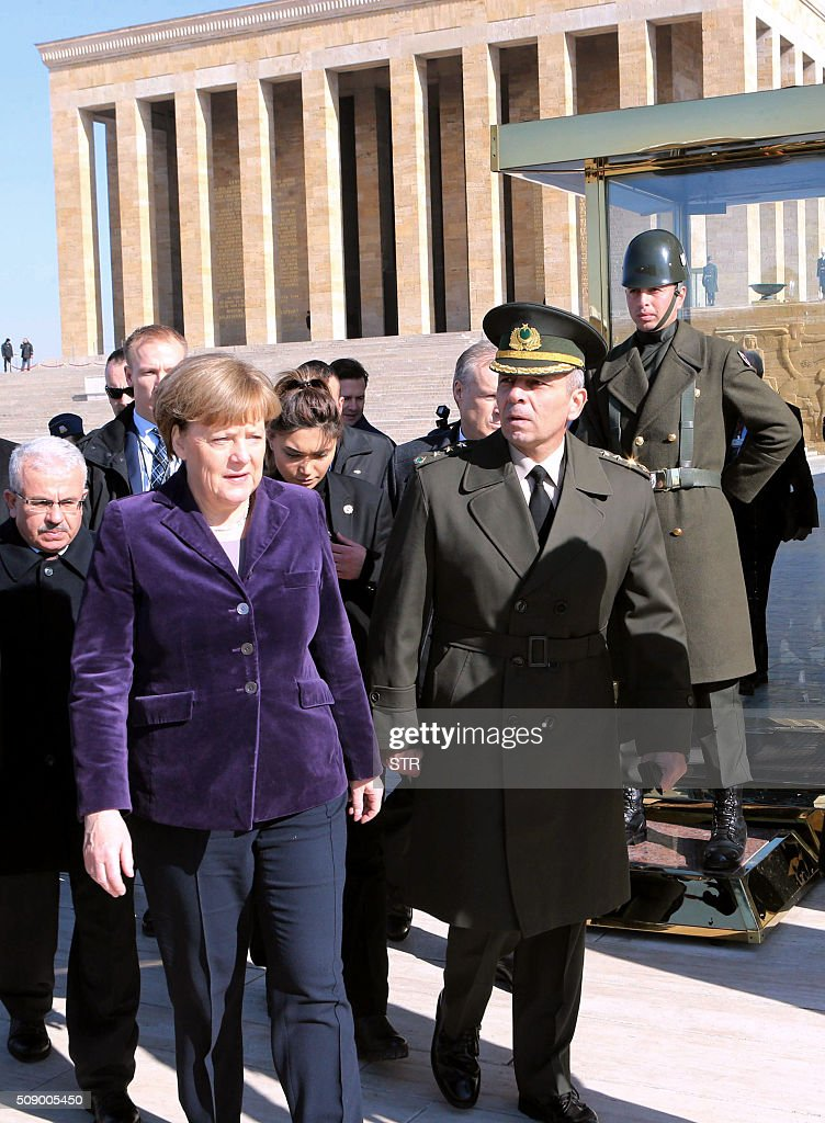 German Chancellor Angela Merkel (L) leaves after her visit to Anitkabir, the mausoleum of Mustafa Kemal Ataturk, founder of the Republic of Turkey, during her visit to Ankara on February 8, 2016. Merkel is to hold talks with Turkey's President Recep Tayyip Erdogan and Prime Minister Ahmet Davutoglu to press Turkey to strengthen border controls to stem the flow of migrants and refugees heading for Europe. / AFP / STR