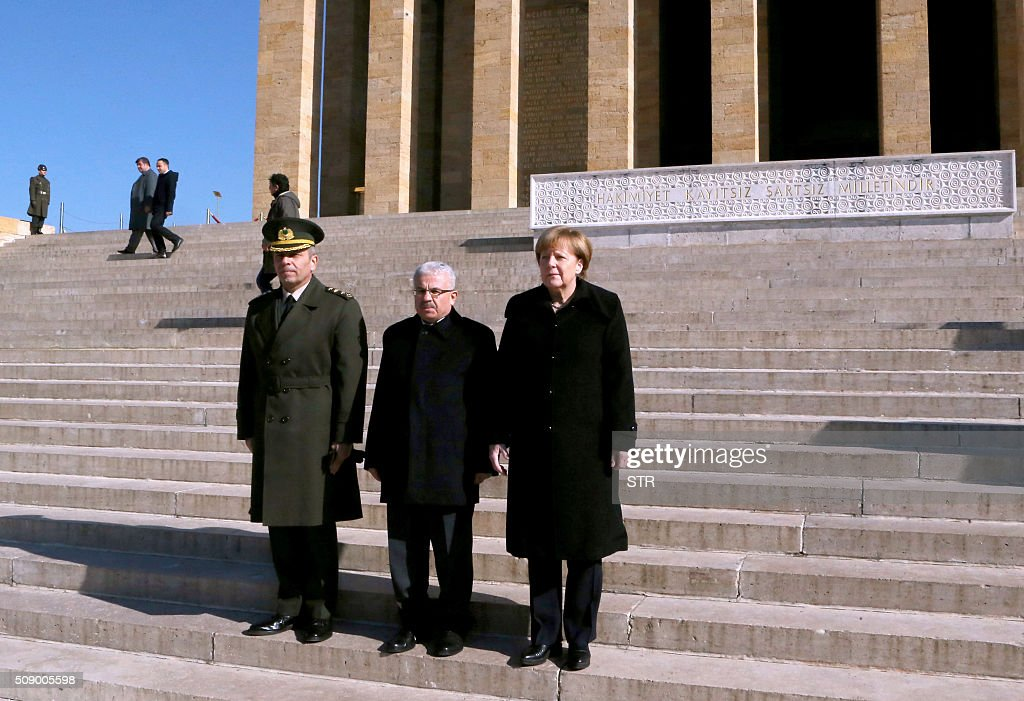 German Chancellor Angela Merkel (R) leaves after her visit to Anitkabir, the mausoleum of Mustafa Kemal Ataturk, founder of the Republic of Turkey, during her visit to Ankara on February 8, 2016. Merkel is to hold talks with Turkey's President Recep Tayyip Erdogan and Prime Minister Ahmet Davutoglu to press Turkey to strengthen border controls to stem the flow of migrants and refugees heading for Europe. / AFP / STR