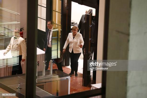 German Chancellor Angela Merkel leaves after members of the delegations of the CDU/CSU conservative alliance the liberal FDP party and the...