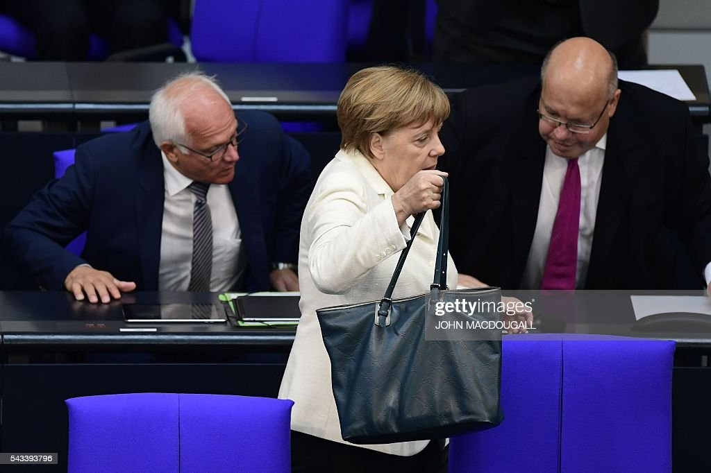 German Chancellor Angela Merkel leaves after she attended a special plenary session on Brexit at the German lower house of Parliament Bundestag in Berlin, on June 28, 2016. / AFP / John MACDOUGALL