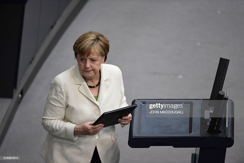 German Chancellor Angela Merkel leaves after she outlined to parliament her vision for the future of Europe following Britain's decision to leave the EU at a special plenary session at the German lower house of Parliament Bundestag in Berlin, on June 28, 2016. / AFP / John MACDOUGALL