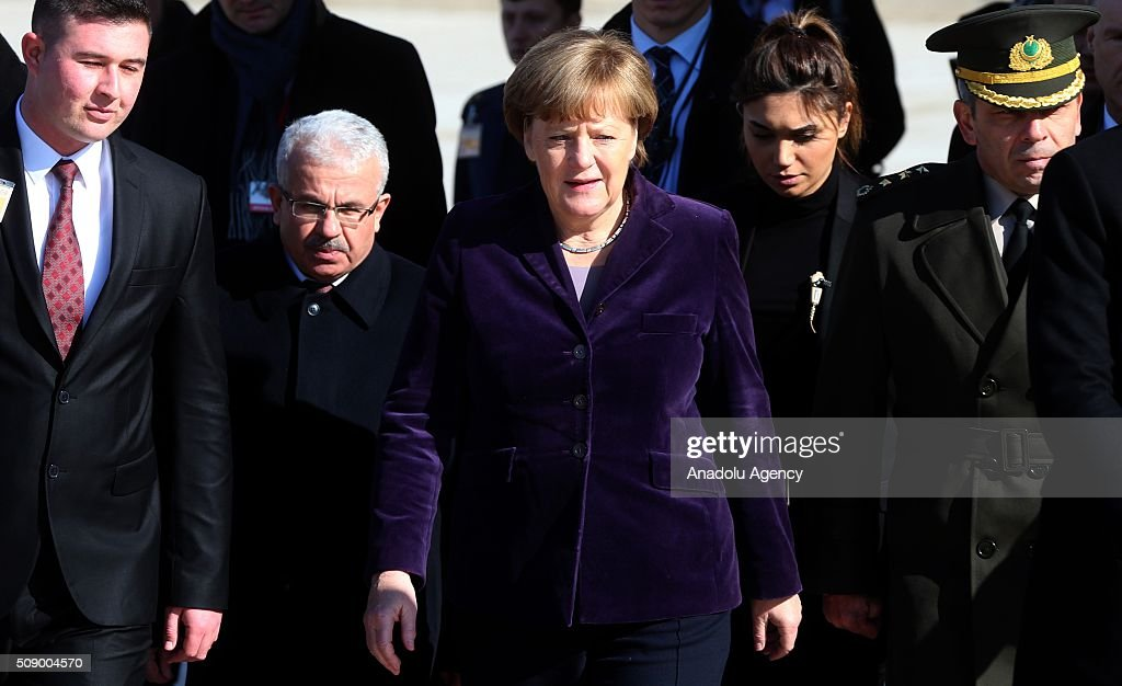 German Chancellor Angela Merkel (C) leaves after visiting Anitkabir, the mausoleum of Mustafa Kemal Ataturk, founder of the Republic of Turkey, during her visit to Ankara, Turkey on February 8, 2016.