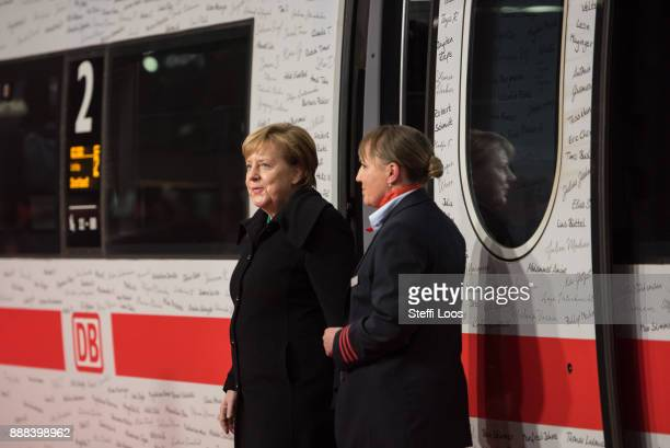 German Chancellor Angela Merkel leaves an ICE high speed train at the main railway station in Berlin during an inauguration of a new fast route...
