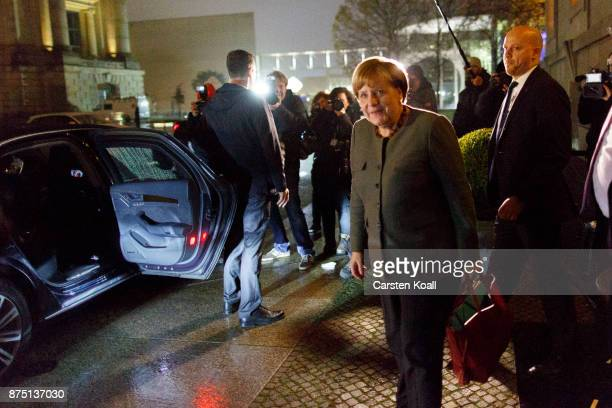 German Chancellor Angela Merkel leaves the last day of preliminary talks over the creation of a new government coalition which are is adjourned on...
