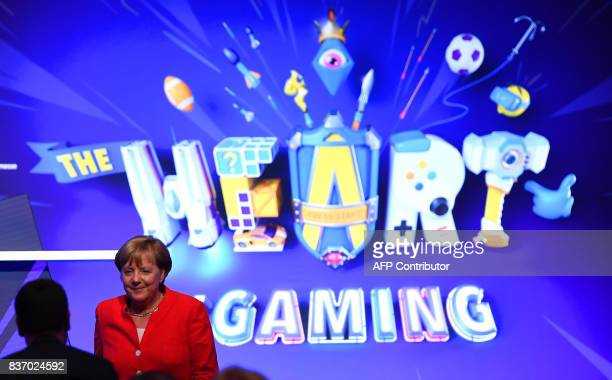 German Chancellor Angela Merkel leaves the stage after the opening speech during the opening ceremony of the gaming fair 'gamescom' in Cologne on...