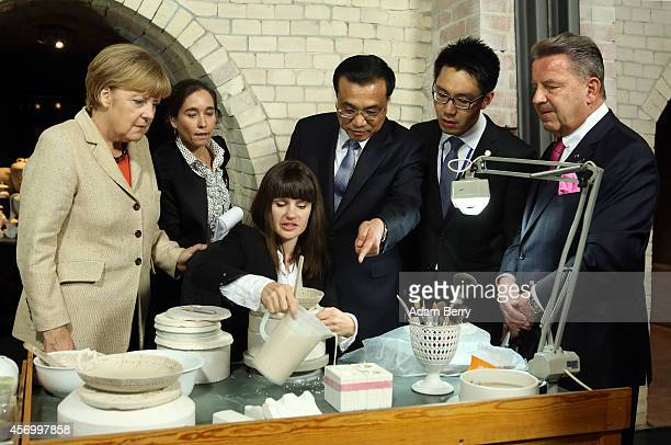 German Chancellor Angela Merkel Li Keqiang premier of the People's Republic of China and party secretary of the State Council and Joerg Woltmann...