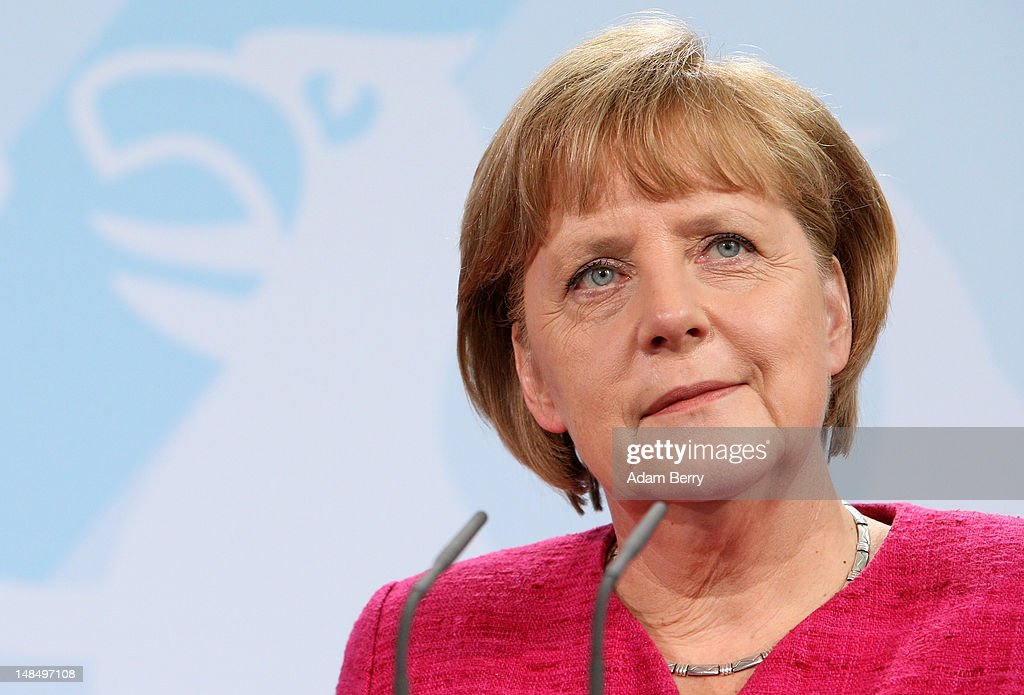 German Chancellor Angela Merkel listens during a news conference with Thai Prime Minister Yingluck Shinawatra at the German federal chancellory on...