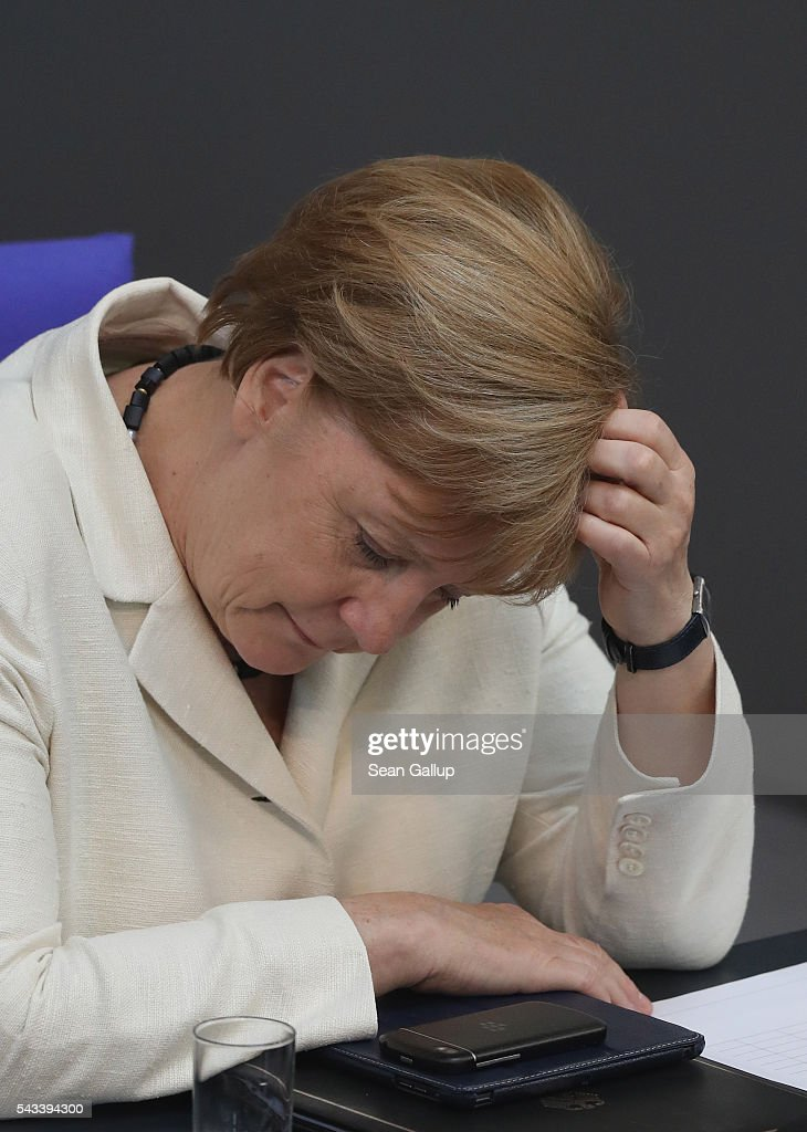 German Chancellor <a gi-track='captionPersonalityLinkClicked' href=/galleries/search?phrase=Angela+Merkel&family=editorial&specificpeople=202161 ng-click='$event.stopPropagation()'>Angela Merkel</a> listens to debates after she addressed the Bundestag with a government declaration on the recent Brexit vote on June 28, 2016 in Berlin, Germany. European leaders are scheduled to meet at a summit in Brussels later today to discuss the consequences of the British vote to leave the European Union. Merkel called the vote an unprecedented event in EU history but one the remaining 27 member states will weather.