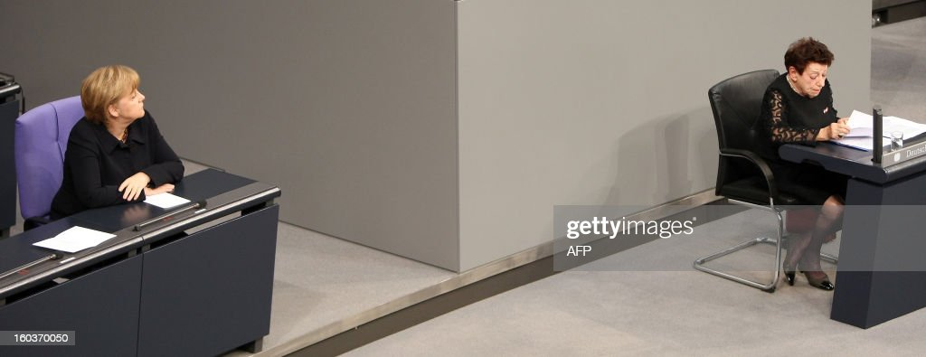 German Chancellor Angela Merkel (L) listens to the speech of German-Israeli writer Inge Deutschkron (R) at the German lower house of Parliament Bundestag, in Berlin on January 30, 2013 during a memorial held by deputies for the victims of the Nazi regime, and the anniversary of the liberation of Auschwitz concentration camp on January 27, 1945. Since the date fell on a Sunday this year, the event was held later, on the day marking 80 years since Adolf Hitler became chancellor. BERRY