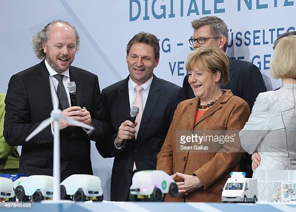 German Chancellor Angela Merkel looks at a presentaiton of 5G technology for traffic at the 2015 IT Summit on November 19 2015 in Berlin Germany The...