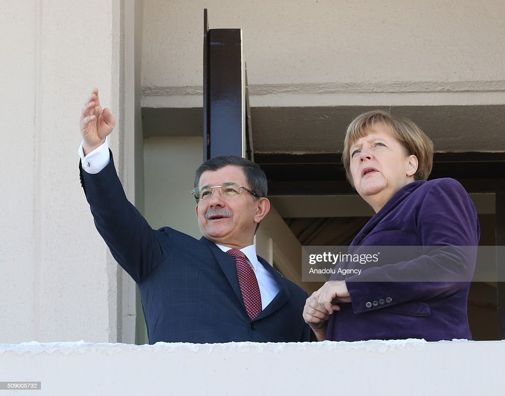 German Chancellor Angela Merkel looks on as Prime Minister of Turkey Ahmet Davutoglu points to the city from the balcony of Cankaya Palace during Angela Merkel's official visit to Ankara, Turkey on February 8, 2016.