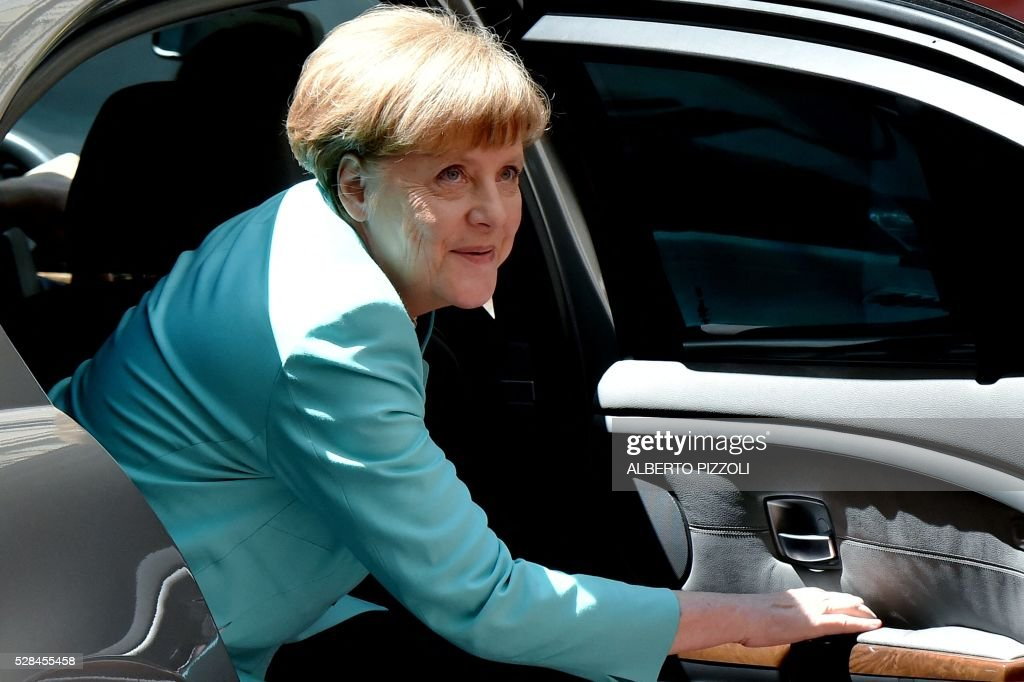 German Chancellor Angela Merkel looks on as she arrives at Rome's Palazzo Chigi on May 5, 2016. EU president Donald Tusk travels to Rome Thursday with fellow EU institution leaders and German Chancellor Angela Merkel for two days of talks likely to focus on next steps in Europe's migrant crisis. Prime Minister Matteo Renzi, who fears Italy becoming the new migrant frontline after the closure of the Balkan route, will host the first day of talks, followed by Pope Francis on Friday. PIZZOLI