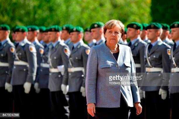 German Chancellor Angela Merkel looks on as she arrives at the Chancellery to welcome French Prime Minister Edouard Philippe in Berlin on September...