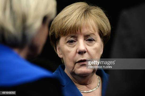 German Chancellor Angela Merkel looks on as she prepares to take her seat upon arrival at the European Parliament in Strasbourg eastern France on...