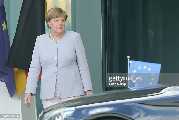 German Chancellor Angela Merkel looks on as the limousine carrying European Council President Donald Tusk arrives four days after the Brexit vote was...