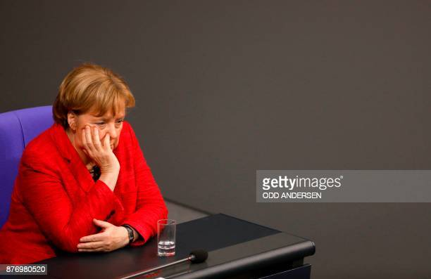 TOPSHOT German Chancellor Angela Merkel looks on during a session at the Bundestag lower house of Parliament on November 21 2017 in Berlin / AFP...