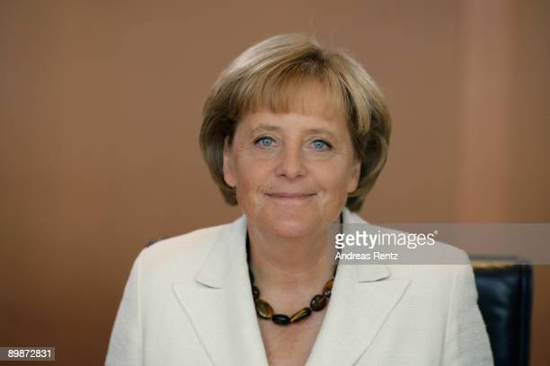 German Chancellor Angela Merkel looks on prior to the weekly German government cabinet meeting at the Chancellery on August 19 2009 in Berlin Germany...